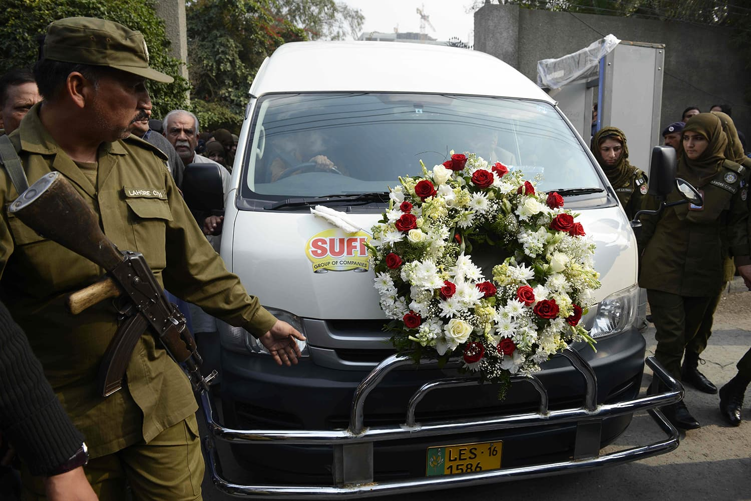 Policemen escort a vehicle carrying the coffin of lawyer and rights advocate Asma Jahangir during her funeral in Lahore on February 13. — AFP