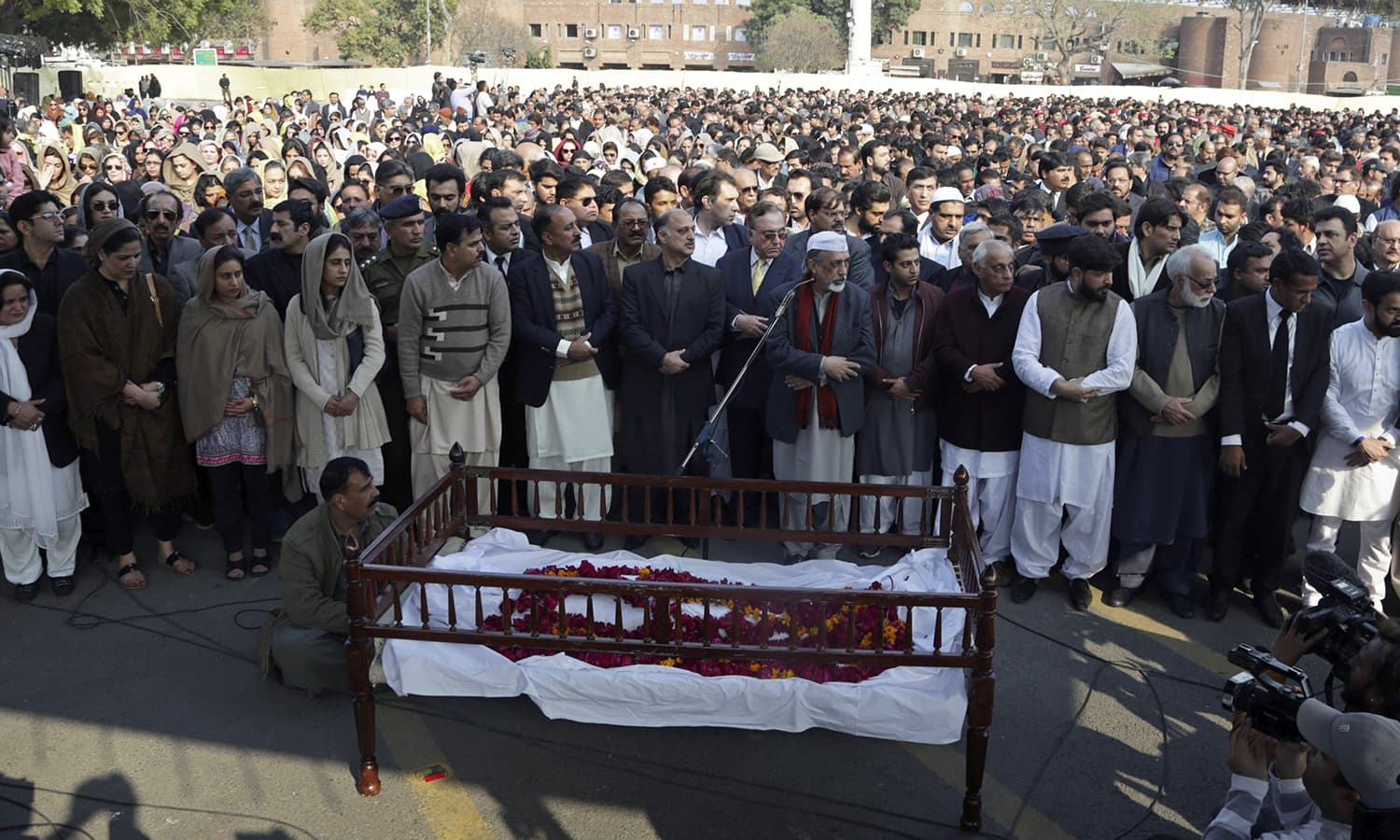People pray during the funeral of Asma Jahangir. — AP