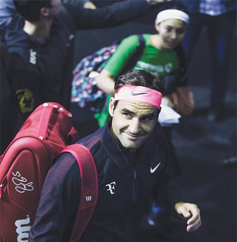ROGER Federer gestures during a training session in Rotterdam on Monday.—AFP