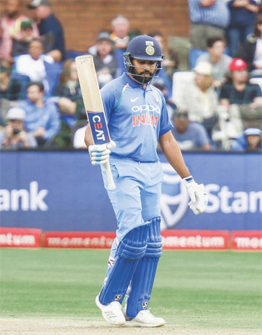 PORT ELIZABETH: Indian opener Rohit Sharma raises bat after completing the century during the fourth ODI against South Africa at St George's Park on Tuesday.—AP