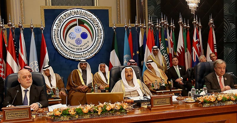 Iraqi Prime Minister Haider al-Abadi (L), Emir of Kuwait Sheikh Sabah al-Ahmad al-Jaber al-Sabah (C) and Secretary general of the United Nations Antonio Guterres attend the second day of an international conference for reconstruction of Iraq, in Kuwait City, on February 14, 2018. — AFP