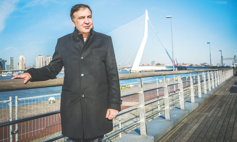 ROTTERDAM (Netherlands): Former Georgian president Mikheil Saakashvili poses in front of the Erasmus Bridge on Wednesday.—AFP