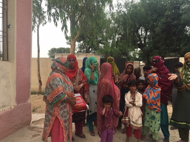 Women in Kathore, Malir whose farms have been destroyed by the land mafia backed by the police.—White Star