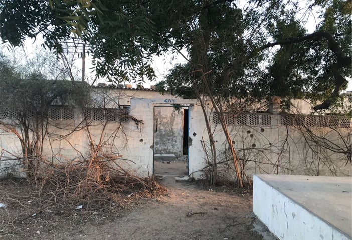 The abandoned farmhouse in Malir where Naqeebullah Mehsud and three others were shot dead in a fake encounter. The bullet holes in the boundary wall can be clearly seen.—White Star