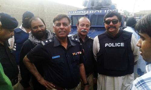 Rao Anwar with his associates — DawnNews/file