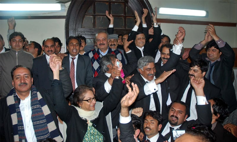 Asma Jahangir and Abid Saqi celebrate the victory of their panel in the Lahore High Court Bar Association election