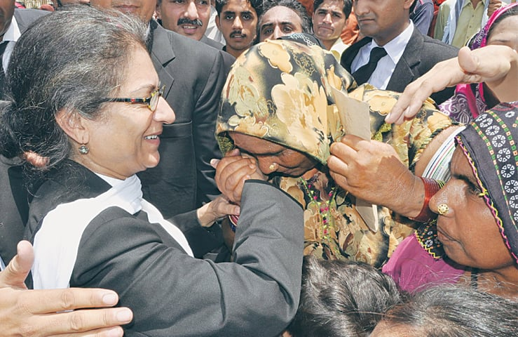 Bonded labourers from Hyderabad embrace Asma Jehangir in gratitude