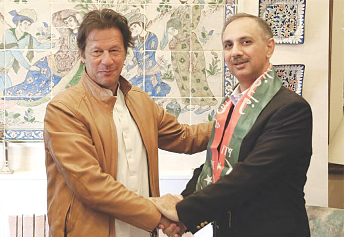 IMRAN Khan and Omar Ayub Khan shake hands after the former PML-N MNA from Haripur announced his decision to join the Pakistan Tehreek-i-Insaf on Saturday.—White Star
