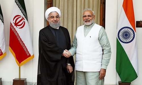 Iranian President Hassan Rouhani (L) shake hands with Indian Prime Minister Narendra Modi before a meeting at Hyderabad house in New Delhi on February 17.— AFP