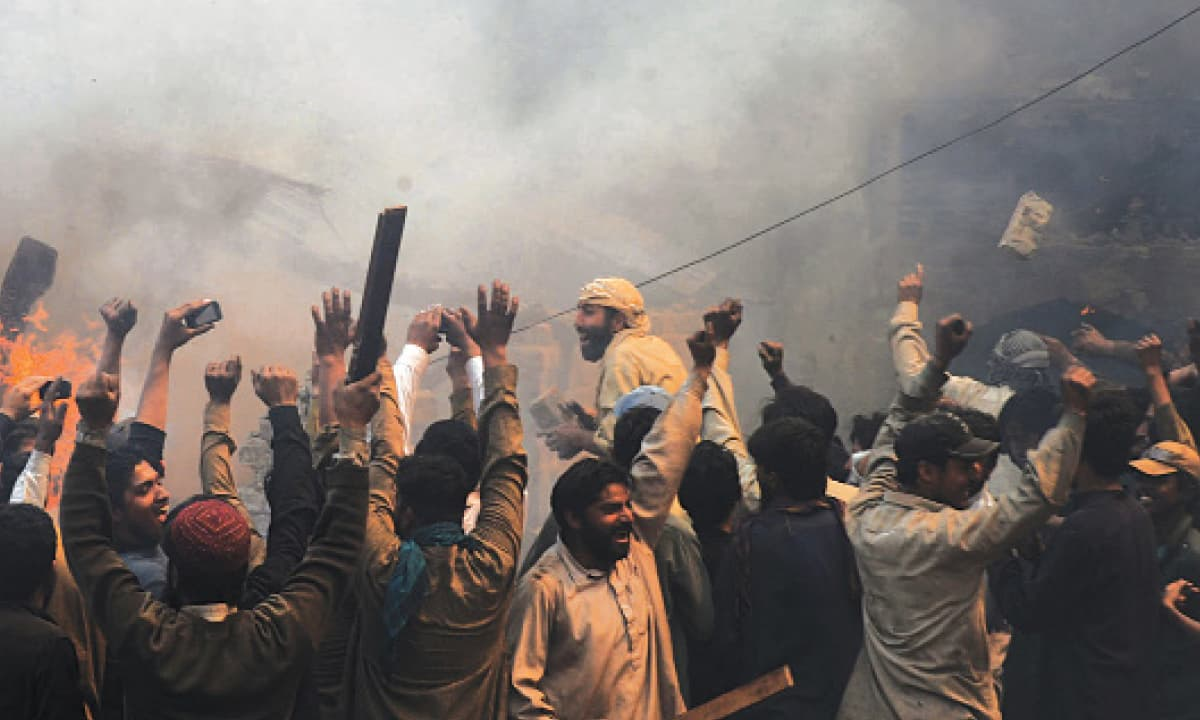 Rioters set fire to homes in Lahore's Joseph Colony, a Christian locality, in 2013  |  M Arif, White Star