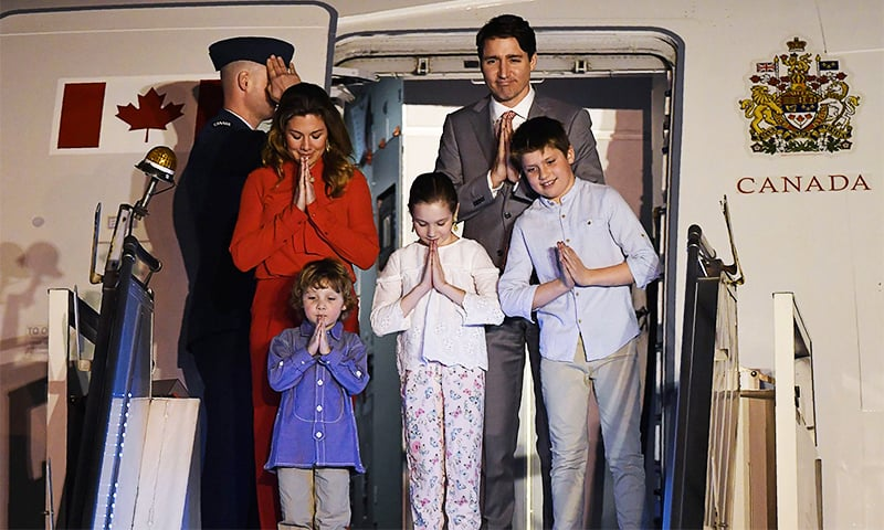 Canadian Prime Minister Justin Trudeau, his wife Gregoire Trudeau and his children arrive at Air Force Station Palam in New Delhi on February 17, 2018. ─ AFP