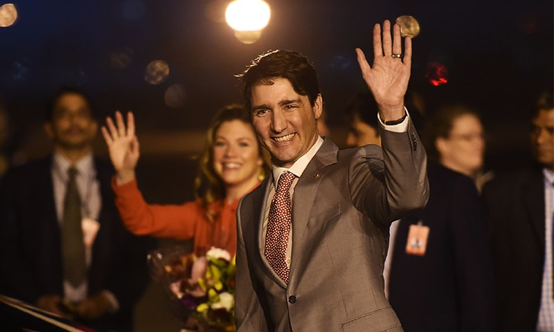 Justin Trudeau and his wife Sophie arrive at Air Force Station Palam in New Delhi on February 17, 2018. ─ AFP