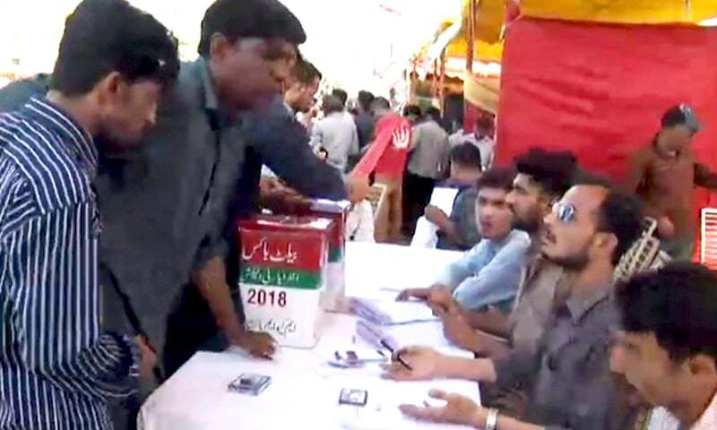 MQM workers vote in the intra-party election. ─ DawnNews