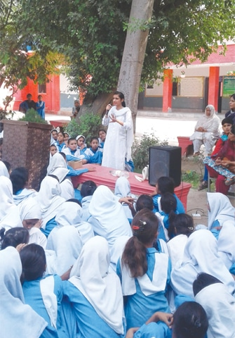 Sadaf Naz explains to girl students in a government school in Okara about the menstrual cycle. Campaigns such as these are expected to remove the stigma from the issue and promote discussions about it to help solve problems for young girls and women.