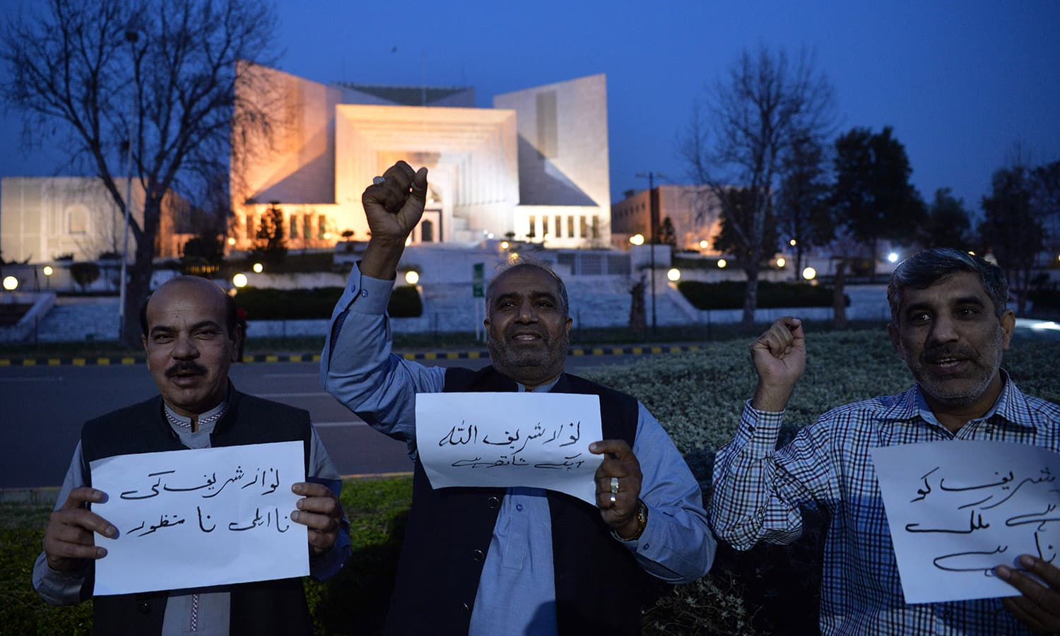 Supporters of ex-PM Nawaz Sharif chant slogans against the court verdict in front of the Supreme Court building on Wednesday. — AFP