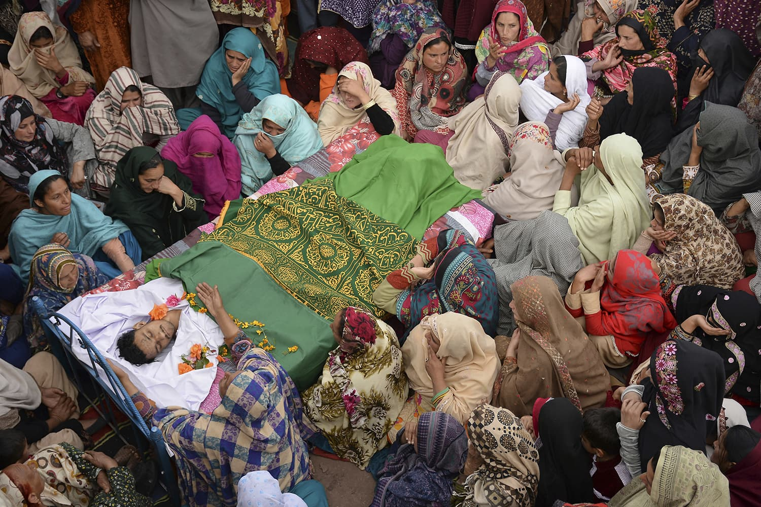 Villagers gather to mourn the death of Pakistani laborer Inzamam Hussain in Tetrinote Hajeera, situated at the Line of Control on Thursday.— AP