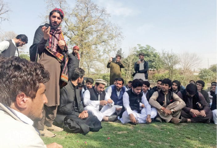 Manzoor Pashtun addresses youth at the University of Peshawar on Thursday. — Dawn