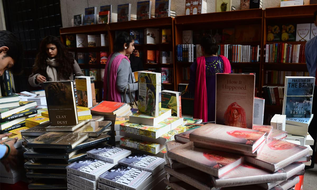 Readers visiting the stalls of the Lahore Literary Festival 2013 | M Arif, White Star
