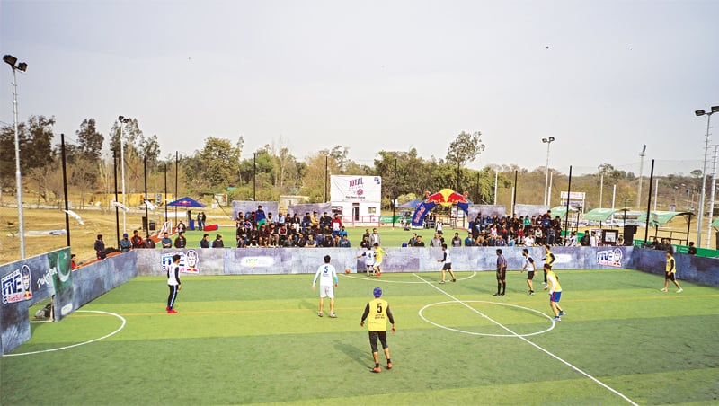 ISLAMABAD: A view of a football match being played here during the Neymar Five event held  last week.