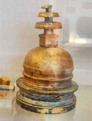 A third century stupa-shaped relic casket decorated with gold leaf, unearthed from Kalawan, near Taxila
