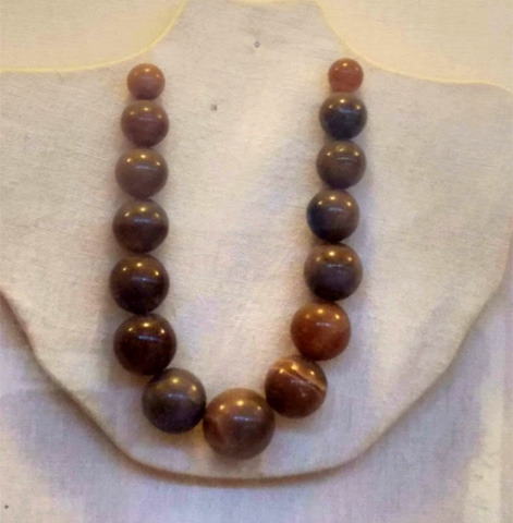 A string of black agate beads found from the Sari Bahlol site dates between first to third century AD