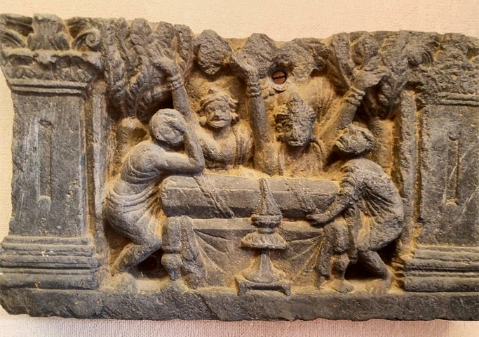 A relic depicting followers of Buddha mourning at his coffin