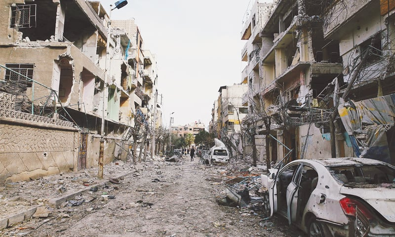 Damascus: Damaged buildings are seen in the besieged town of Douma, Eastern Ghouta, on Sunday.—Reuters