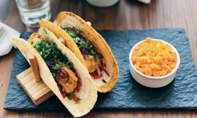 The peanut crusted sea bass comes with a tangy Vietnamese sauce while the sauce used in the fish tacos lends it a fiery punch.
