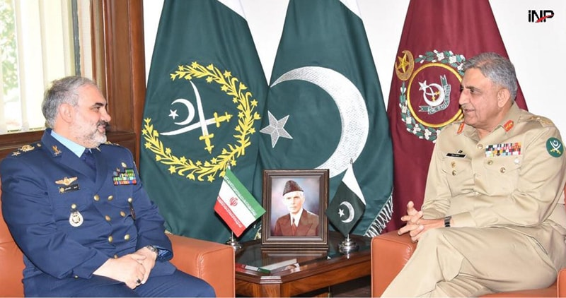 RAWALPINDI: Chief of the Army Staff Gen Qamar Javed Bajwa speaks to the top commander of Iran's air force, Brig Gen Hassan Shahsafi, who called on him at GHQ on Monday.—INP