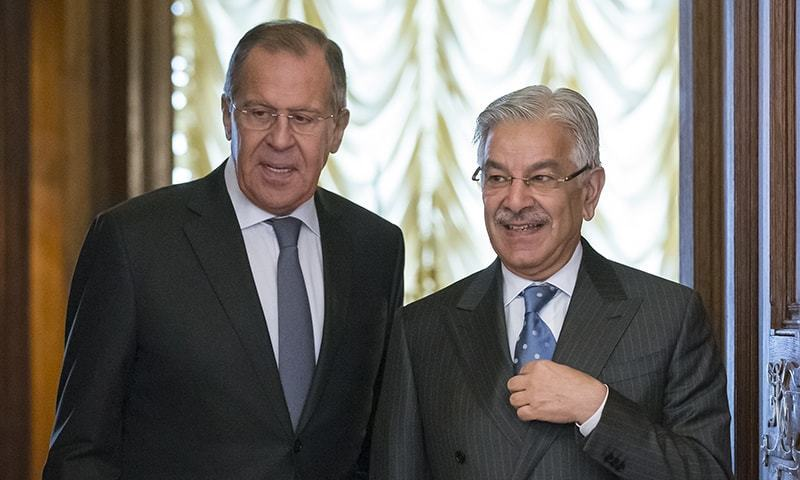 Russian Foreign Minister Lavrov, left, and Pakistan's Foreign Minister Khawaja Muhammad Asif enter a hall for their talks in Moscow last week. — File