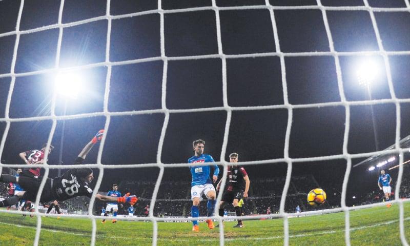 CAGLIARI: Napoli's Jose Callejon (C) scores past Cagliari goalkeeper Alessio Cragno during the Serie A match at the Sardegna Arena.—Reuters