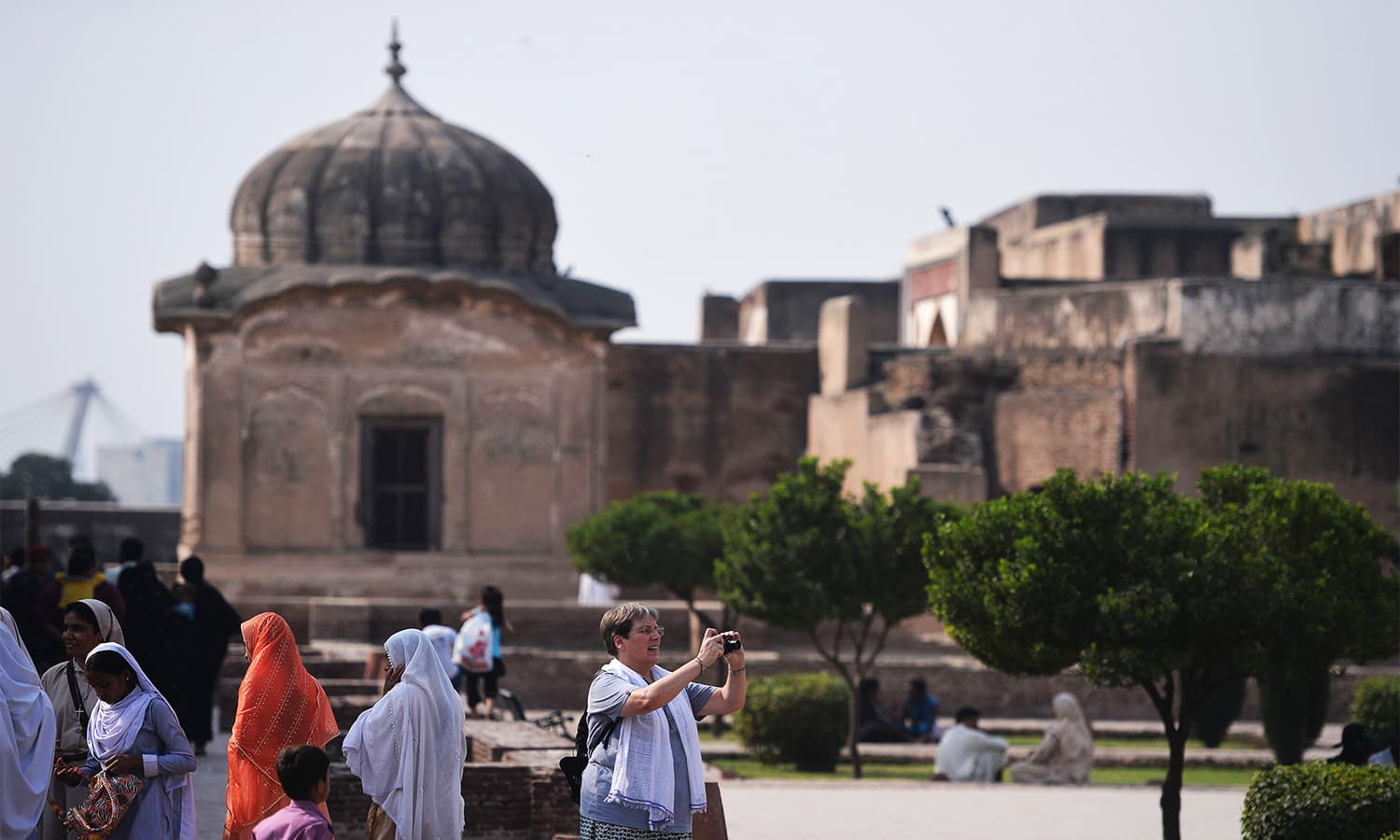 Tourists visit the historic Mughal-era Lahore Fort. ─ AFP