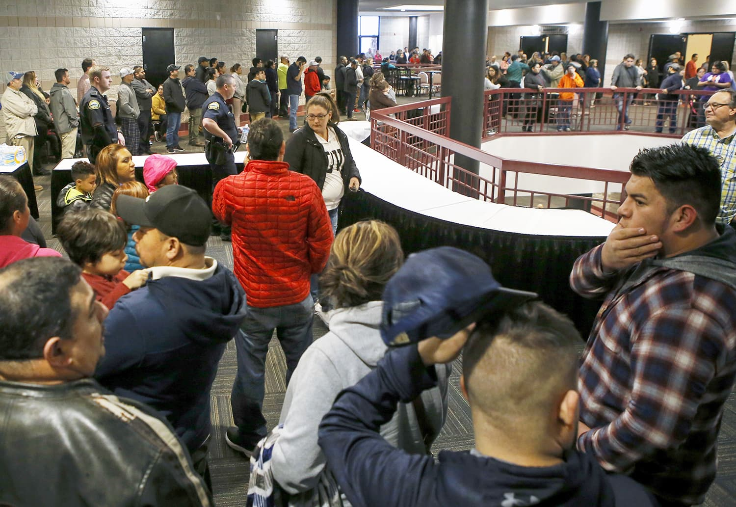 People lineup inside the Dalton Convention Center to pick up their children on Wednesday, Feb. 28, 2018, in Dalton, Ga. Students from Dalton High School were evacuated to the convention center after social studies teacher Randal Davidson barricaded himself in a classroom and fired a handgun, authorities said.  ─AP