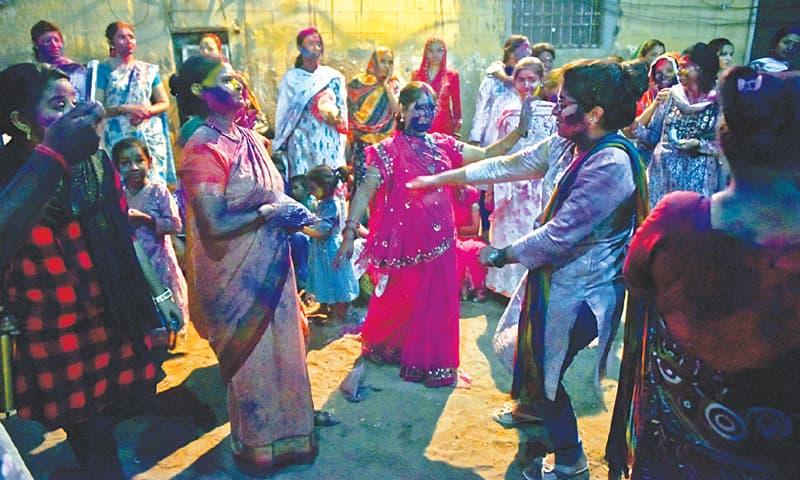 REVELLERS celebrate Holi at the Swaminarayan Mandir on Thursday evening.—White Star