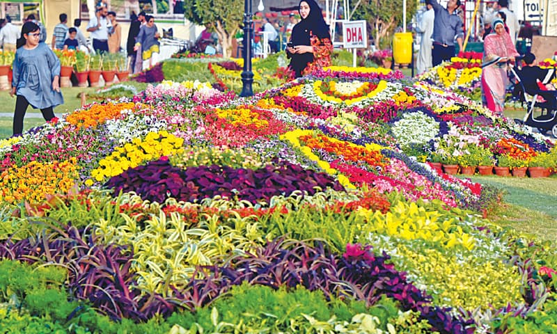 VISITORS throng the annual flower show, which opened at A.K. Khan Park on Thursday.—Fahim Siddiqi/White Star