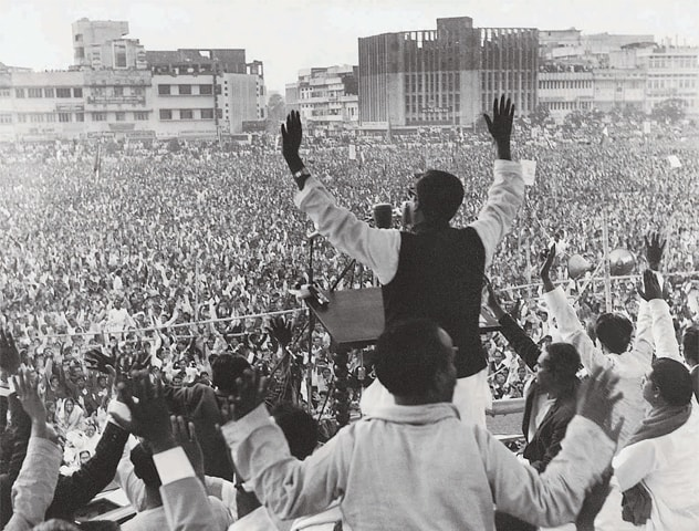 Sheikh Mujibur Rahman, chief of the Awami League, addressing a public rally in Dhaka's Paltan Maidan during his election campaign | Photo: Dawn/White Star Archives