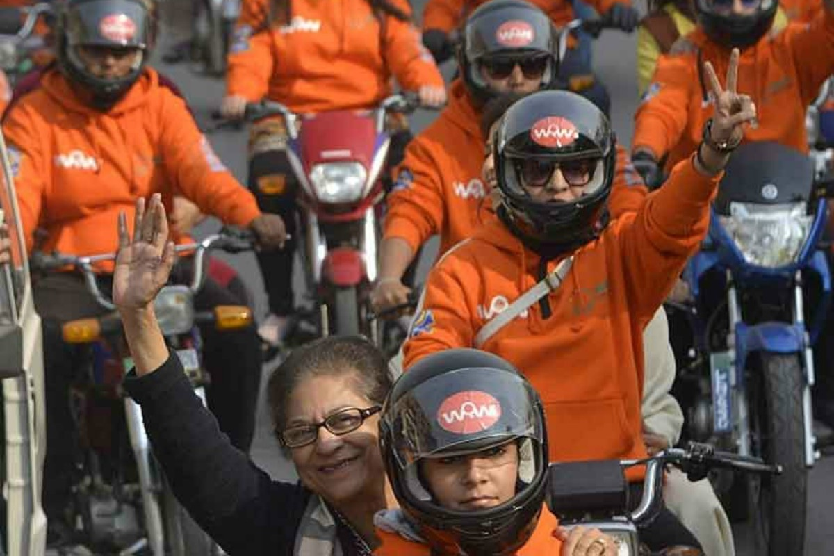A gleeful Asma Jahangir participates in the Women on Wheels rally in Lahore in 2016
