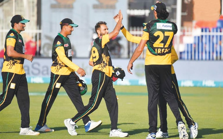 SHARJAH: Hat-trick hero Imran Tahir does a high-five with one of his Multan Sultans team-mates during the PSL match against Quetta Gladiators at the Sharjah Cricket Stadium on Saturday.