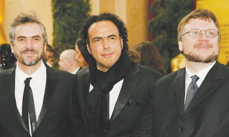 MEXICAN directors Alfonso Cuaron (left), Alejandro Gonzalez Inarritu (centre) and Guillermo del Toro have won international acclaim, but struggle to get traction at home.—AFP