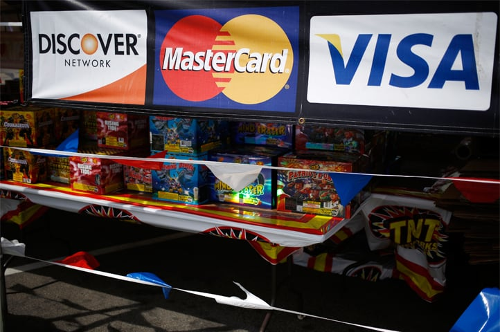 IN this file photo, Visa, Mastercard and Discover Network credit card signage is displayed at a fireworks stand in Shepherdsville, Kentucky.— Bloomberg