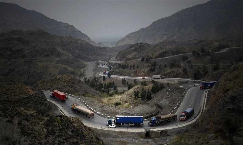 Trucks and other vehicles travel through the mountains near Torkham border. Pakistan's market share in Afghanistan is being receded to India and China as its exports fell to $1.24bn in 2016-17 from $1.437bn 2015-16.