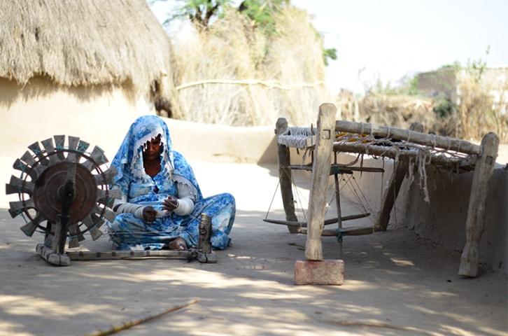 Sukhan works on a khaddi in her courtyard