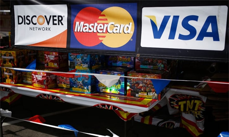 Debt-conscious millennials ditch credit cards, threaten industry