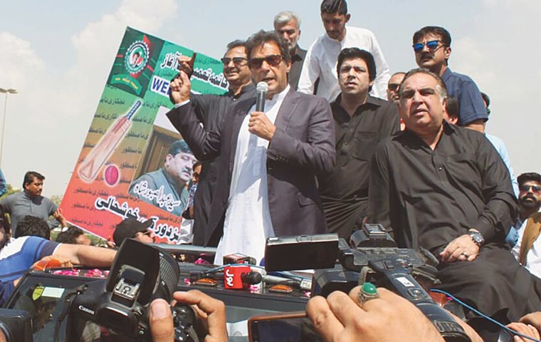 KARACHI: Pakistan Tehreek-i-Insaf chairman Imran Khan addresses his party's workers at the airport on Sunday.—Online