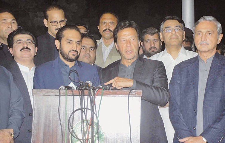 PTI leader Imran Khan addressing a press conference with Balochistan Chief Minister Mir Abdul Quddus Bizenjo.—Online