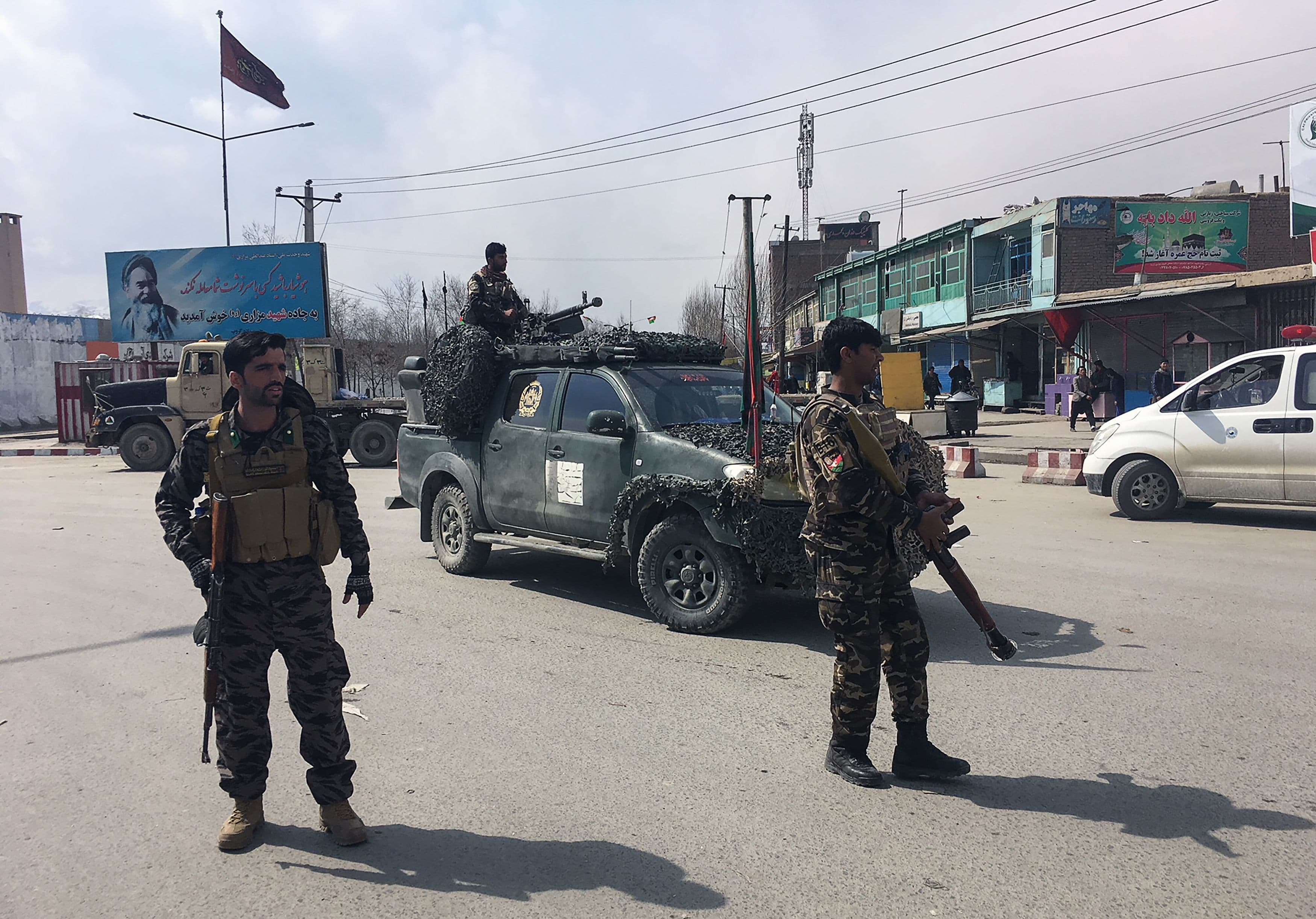 Afghan security forces keep watch near the site of an explosion in Kabul on March 9, 2018. ─AFP