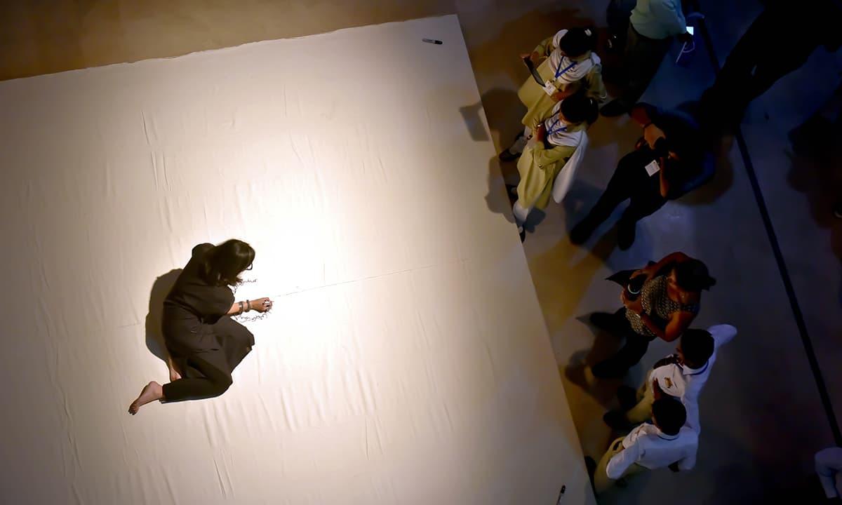 Tazeen Qayyum performing at the Karachi Biennale 2017| Malika Abbas, White Star