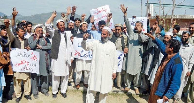 People chant slogans during a protest against delimitation of constituencies in Dir Lower. — Online