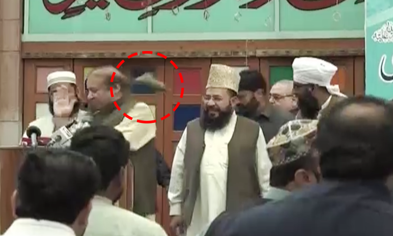 Shoe thrown at Nawaz Sharif after he arrived on the stage to address the crowd.─DawnNewsTV