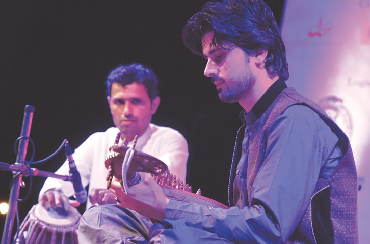 Liaquat Humayoon and Irfan Haider perform at the event.—White Star
